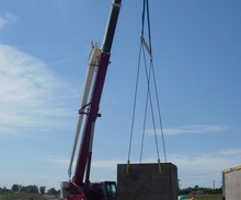 Crane lift from truck to pit.JPG