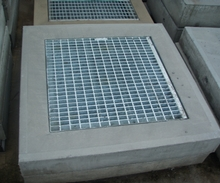 Hinged Grate in concrete.JPG